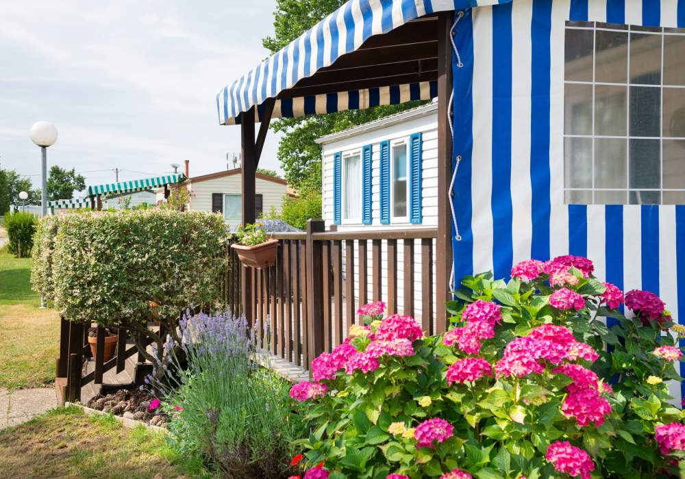 Mobile home with beautiful pink flowers in front
